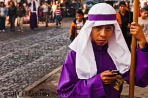 Purple-robed cell phone boy