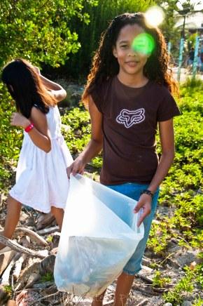 Angelina picking up trash