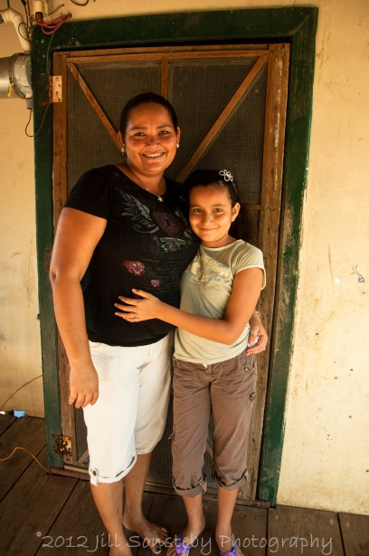 Mother and daughter in front of their house in campolacho.