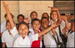 Kids swarm us when we get to the public school of Utila, Honduras.