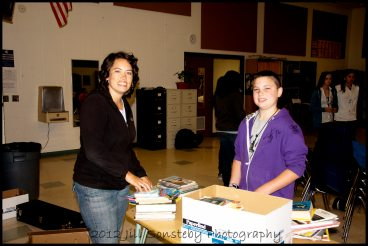 Me and Colsen boxing up books at Syringa Middle School, ID to be shipped to Utila, Bay Islands, Honduras