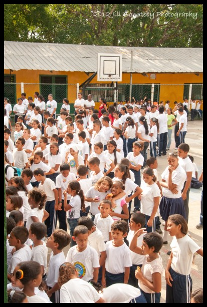 children standing in court during the assembly at CEBRH in Utila, Honduras.