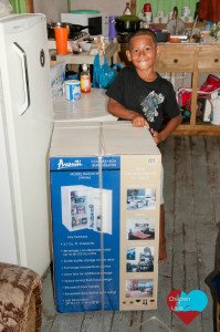 little boy excited about the new fridge after not having one