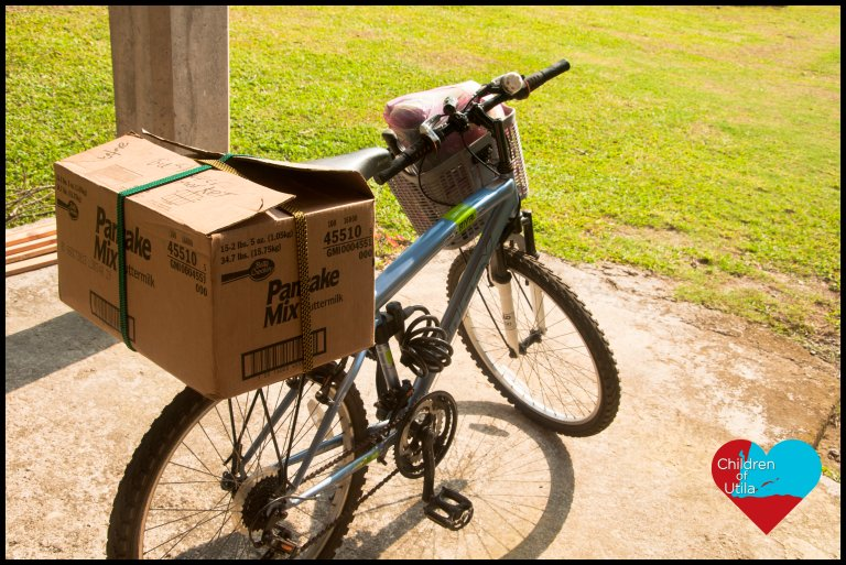 Donated school supplies assembled into packages and put in a box on my bike to deliver to each teacher at Utila's public school