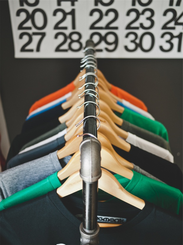 t-shirts on hangers all in a row showing conformity